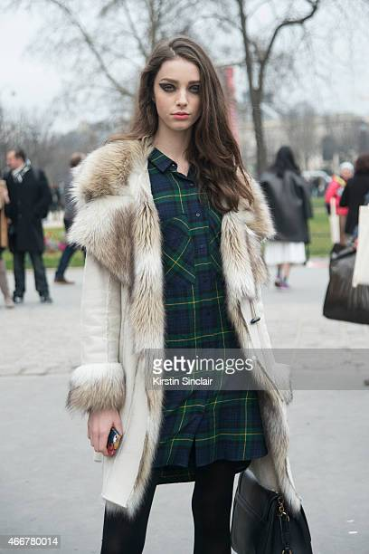 Model Larissa Marchiori wears an INC coat Dolce and Gabanna bag and vintage dress on day 8 of Paris Collections Women on March 10 2015 in Paris France
