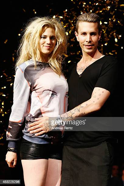 Model Larissa Marolt and designer Florian Wess smile after the GarconF fashion show at Balloni-Hallen on August 5, 2014 in Cologne, Germany.