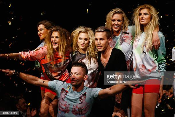Model Larissa Marolt and designer Florian Wess smile after the GarconF fashion show at BalloniHallen on August 5 2014 in Cologne Germany
