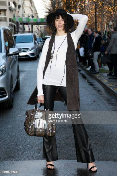 Model Larissa Thome poses in front of the Plaza Athenee hotel on December 8 2017 in Paris France