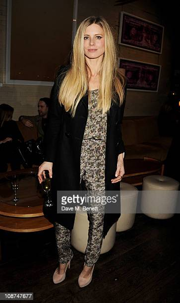 Model Laura Bailey attends the British Fashion Council/Vogue Designer Fashion Fund cocktail reception to celebrate winner Christopher Kane at Almada...