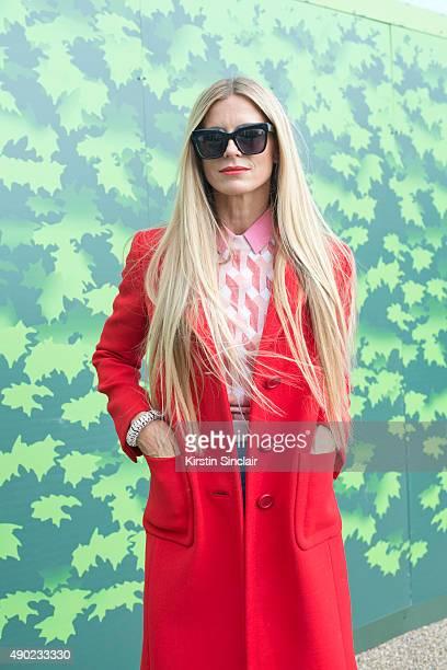 Model Laura Bailey wears a Prada coat Jonathan Saunders sweater vintage shirt and Zanzan sunglasses on day 3 during London Fashion Week Spring/Summer...