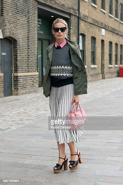 Model Laura Bailey wears a vintage shirt Penelope Chilvers shoes Zanzan sunglasses and Prada bag on day 3 during London Fashion Week Spring/Summer...
