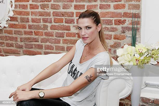 Model Laura Sanchez gets charity tatoos during the campaign against cancer 'Me Pongo En Tu Piel' on September 18, 2014 in Madrid, Spain.