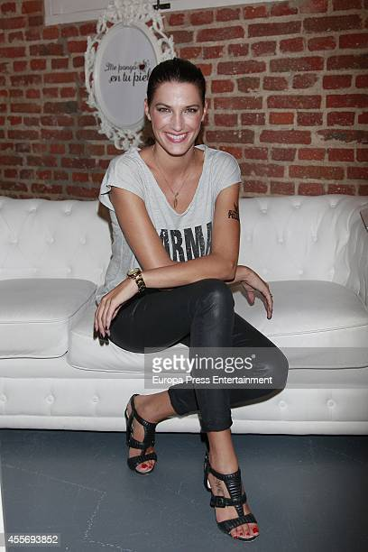 Model Laura Sanchez gets charity tatoos during the campaign against cancer 'Me Pongo En Tu Piel' on September 18 2014 in Madrid Spain