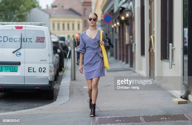 Model Lea Meyer wearing a plaid dress yellow bag black sandals outside Vanessa Rudjord on August 24 2017 in Oslo Norway