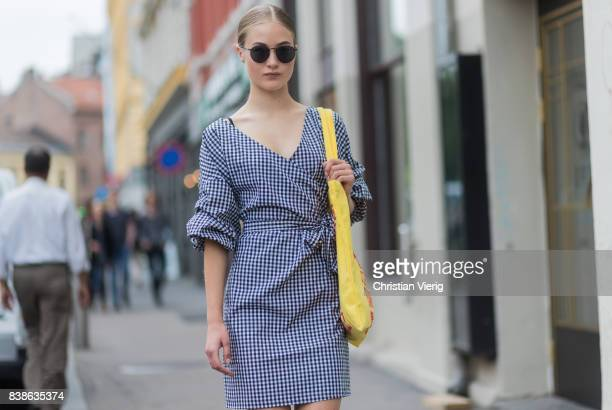 Model Lea Meyer wearing a plaid dress yellow bag outside Vanessa Rudjord on August 24 2017 in Oslo Norway