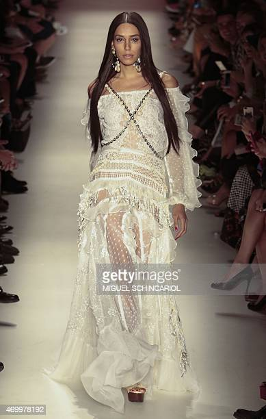 Model Lea T presents a creation by Teca by Helo Rocha during the 2016 Summer collections of the Sao Paulo Fashion Week in Sao Paulo Brazil on April...