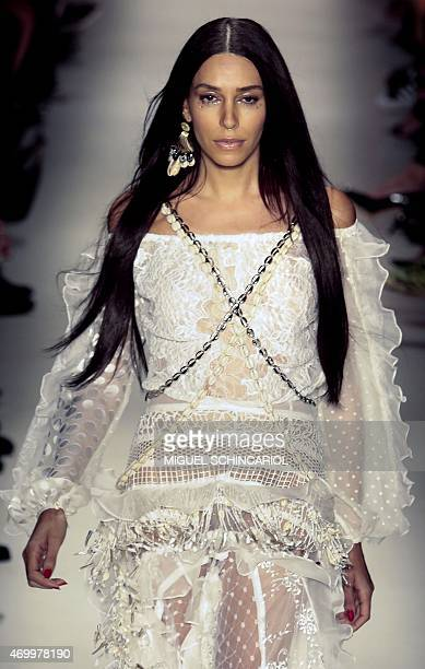 Model Lea T presents a creation Teca by Helo Rocha during the 2016 Summer collections of the Sao Paulo Fashion Week in Sao Paulo Brazil on April 16...