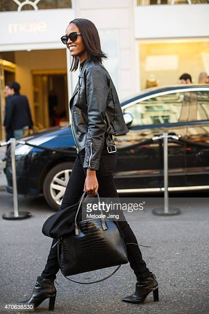 Model Leila Nda exits the Balmain show with a Le Tanneur bag at the Grand Hotel on Day 3 of Paris Fashion Week FW15 on March 5 2015 in Paris France