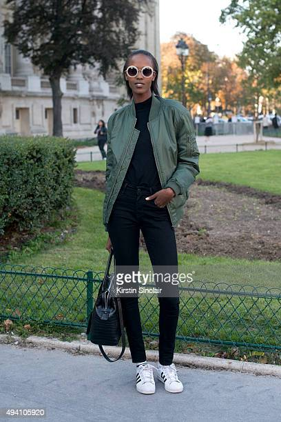 Model Leila Nda wears Adidas trainers a Classic Urban jacket Levi jeans Derek Lam sunglasses and Givency bag on day 3 during Paris Fashion Week...