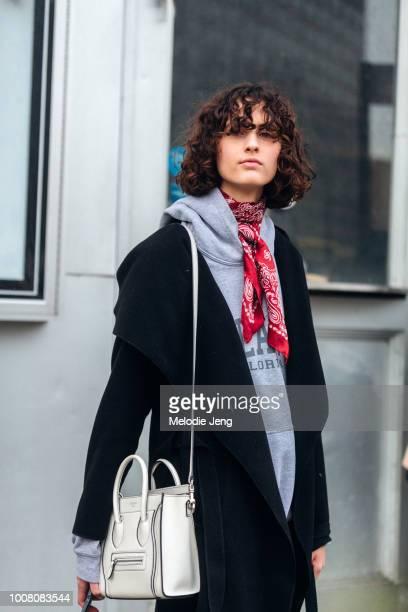 Model Leila Zandonai wears a red bandana scarf black jacket and white Celine bag on Day 3 of New York Fashion Week Fall/Winter 2017 on February 11...