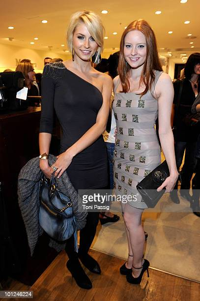 Model Lena Gercke and model Barbara Meier attend the 'Sex And The City 2' movie night at the Peek Cloppenburg flagship store on May 28 2010 in Berlin...