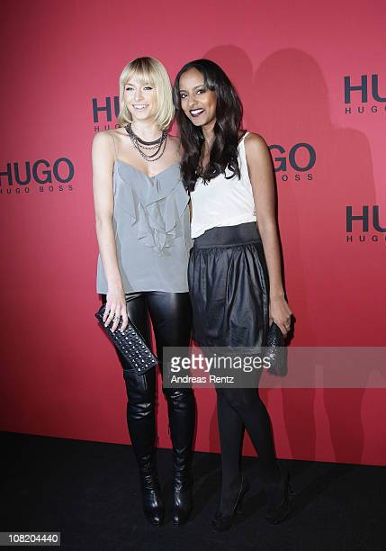 Model Lena Gercke and model Sara Nuru attend the Hugo Boss Show during the Mercedes Benz Fashion Week Autumn/Winter 2011 at Neue Nationalgalerie on...