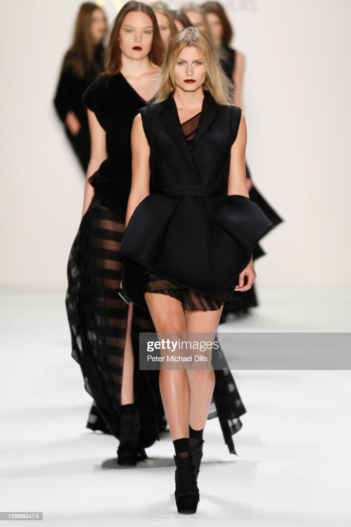 Model Lena Gercke walks down the Runway at Irina Schrotter Autumn/Winter 2013/14 fashion show during Mercedes-Benz Fashion Week Berlin at Brandenburg Gate on January 18, 2013 in Berlin, Germany.