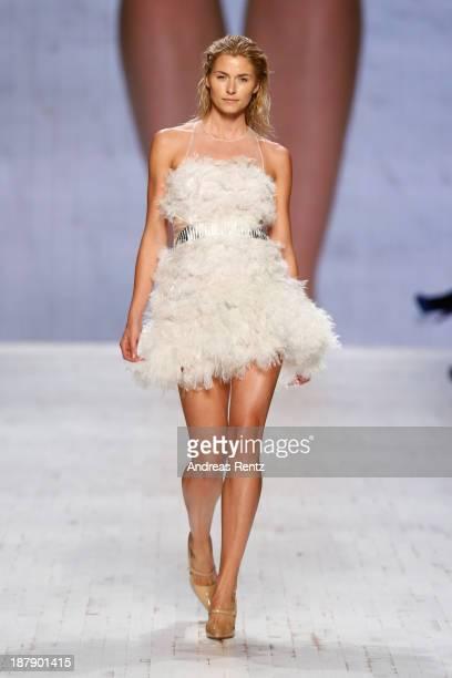 Model Lena Gercke walks the runway at the Felder Felder show during MercedesBenz Fashion Days Zurich 2013 on November 13 2013 in Zurich Switzerland