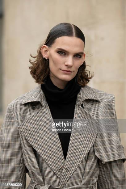 Model Lena Hardt wears a Paco Rabanne trench coat on September 26 2019 in Paris France