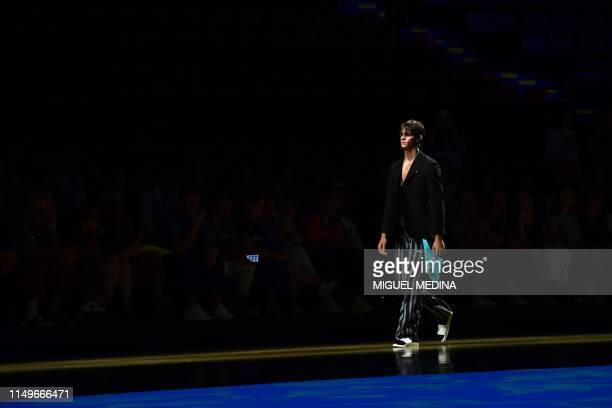 Model Leonardo Tano the son of Italian pornographic actor Rocco Siffredi presents a creation during the presentation of Italian fashion brand MSGM's...