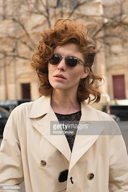 Model Leonore Masson wears Etam body Other Stories trench coat and Cutler and Gross sunglasses on day 2 of Paris Collections Women on March 04 2015...