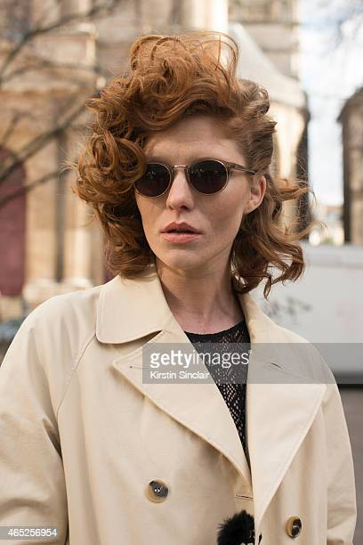 Model Leonore Masson wears Etam body Other Stories trench coat and Cutler and Gross glasses on day 2 of Paris Collections Women on March 04 2015 in...