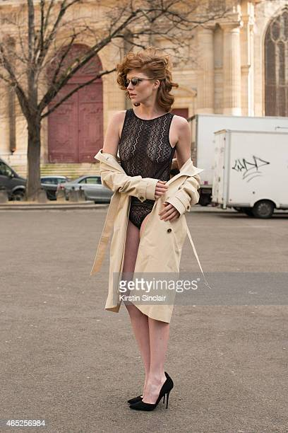 Model Leonore Masson wears Etam body Other Stories trench coat Steven Madden Shoes Cutler and Gross sunglasses on day 2 of Paris Collections Women on...