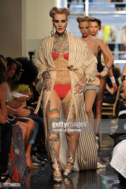 Model Lexy Hell walks the runway during the Jean Paul Gaultier Ready to Wear Spring / Summer 2012 show during Paris Fashion Week on October 1, 2011...