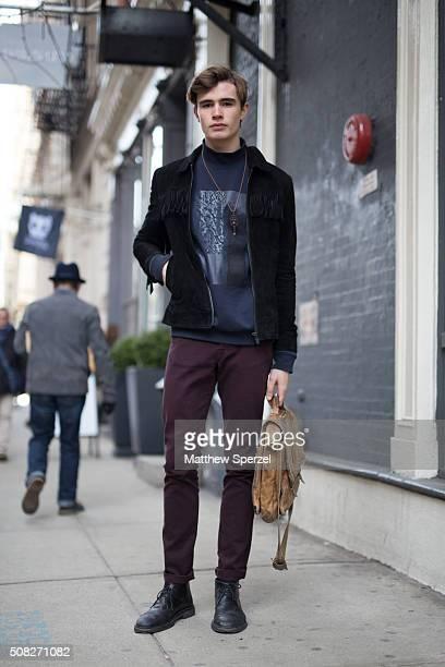 Model Liam Little is seen on Broome Street wearing suede Zara jacket Plac Jeans sweatshirt Kooples pants Agnes B shoes vintage Jeffrey Bean bag and...