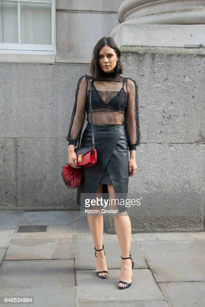 Model Lilah Parsons wears a River Island top and skirt MCM bag and Giuseppe Zanotti shoes on day 2 of London Womens Fashion Week Autumn/Winter 2017...