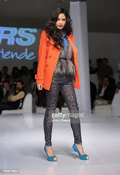 Model Liliana Camba walks the runway during the Sears Fashion Parade Autumn/Winter 2012 show at Soumaya museum on August 27 2012 in Mexico City Mexico