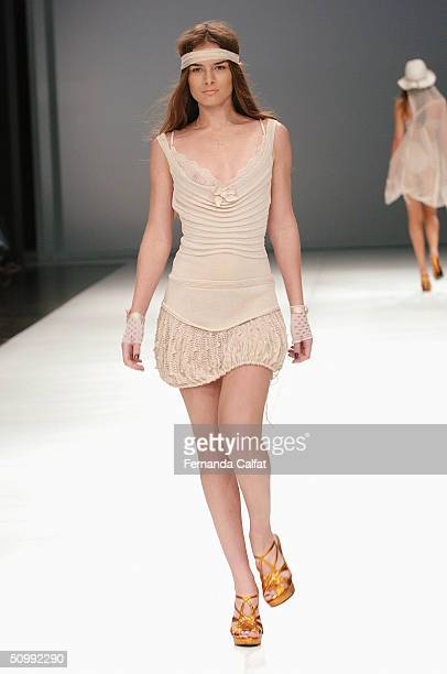 Model Liliane Ferrarezi walks the runway at the Patachou 2005 Spring/Summer collection during the Sao Paulo Fashion Week June 17 2004 in Sao Paulo...