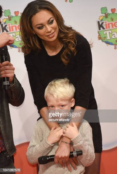 Model Lilly Becker and her son Amadeus pose during a campaign by the 'kinder' brand of sweets manufacturer Ferrero on teh occasion of Universal...