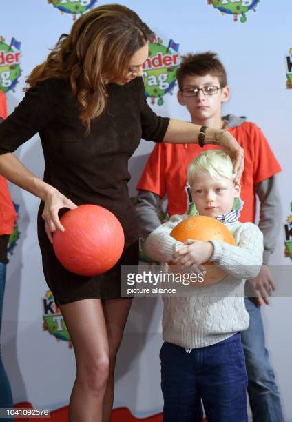 Model Lilly Becker and her son Amadeus pose with bowling balls during a campaign by the 'kinder' brand of sweets manufacturer Ferrero on teh occasion...