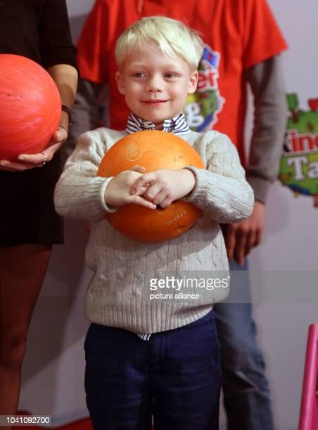Model Lilly Becker's son Amadeus poses with a bowling ball during a campaign by the 'kinder' brand of sweets manufacturer Ferrero on teh occasion of...