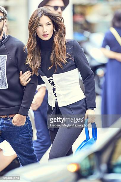 Model Lily Aldridge poses at a fashion shoot for Madame Figaro on July 30 2016 in Paris France Jacket pullover corset pants earrings bag PUBLISHED...