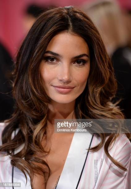 Model Lily Aldridge poses at the 2013 Victoria's Secret Fashion Show hair and makeup room at Lexington Avenue Armory on November 13 2013 in New York...