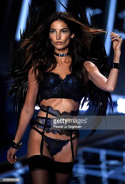 Model Lily Aldridge walks the runway at the annual Victoria's Secret fashion show at Earls Court on December 2 2014 in London England