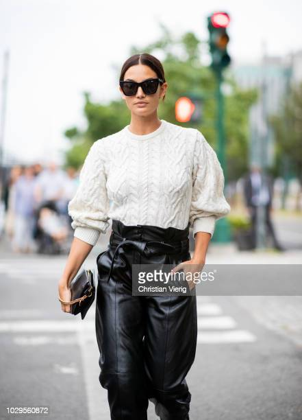 Model Lily Aldridge wearing knit, black cropped leather pants is seen outside Brandon Maxwell during New York Fashion Week Spring/Summer 2019 on...