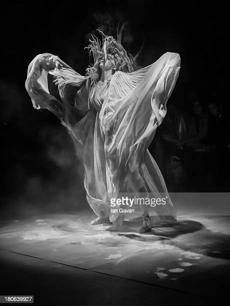 Model Lily Cole dances on stage during the Vivienne Westwood Red Label show during London Fashion Week SS14 at the German Gymnasium on September 15...