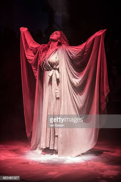 Model Lily Cole dances on stage prior to the Vivienne Westwood Red Label show during London Fashion Week SS14 at the German Gymnasium on September 15...