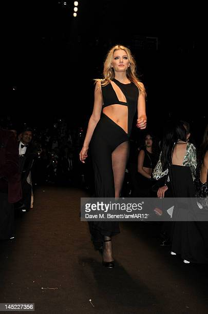 Model Lily Donaldson walks the runway during the 2012 amfAR's Cinema Against AIDS during the 65th Annual Cannes Film Festival at Hotel Du Cap on May...