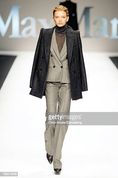Model Lily Donaldson walks the runway wearing MaxMara at the Fall/Winter 2008/2009 collection during Milan Fashion Week on February 21 2008 in Milan...