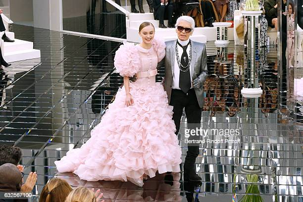 Model LilyRose Depp and Stylist Karl Lagerfeld acknowledge the applause of the audience in front of LilyRose's mother Vanessa Paradis at the end of...