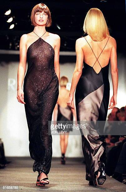 Model Linda Evangelista wears a sparkling backless evening gown while another model wears a similar design in two-tone silk in the Ralph Lauren Fall...