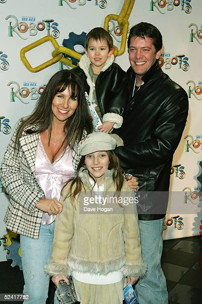 Model Linda Lusardi and her husband actor Samuel Kane and their family arrive at the UK premiere of the animated film 'Robots' at Vue Leicester...
