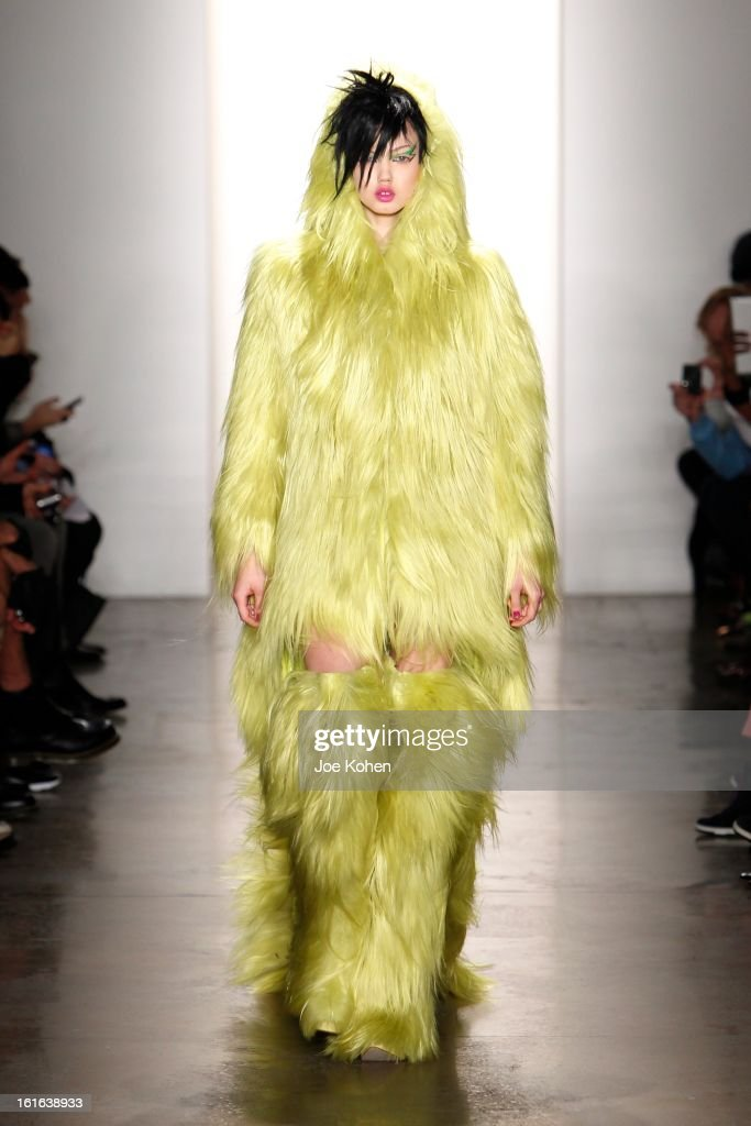 Model Lindsey Wixson walks the runway at the Jeremy Scott fall 2013 fashion show during MADE Fashion Week at Milk Studios on February 13, 2013 in New York City.