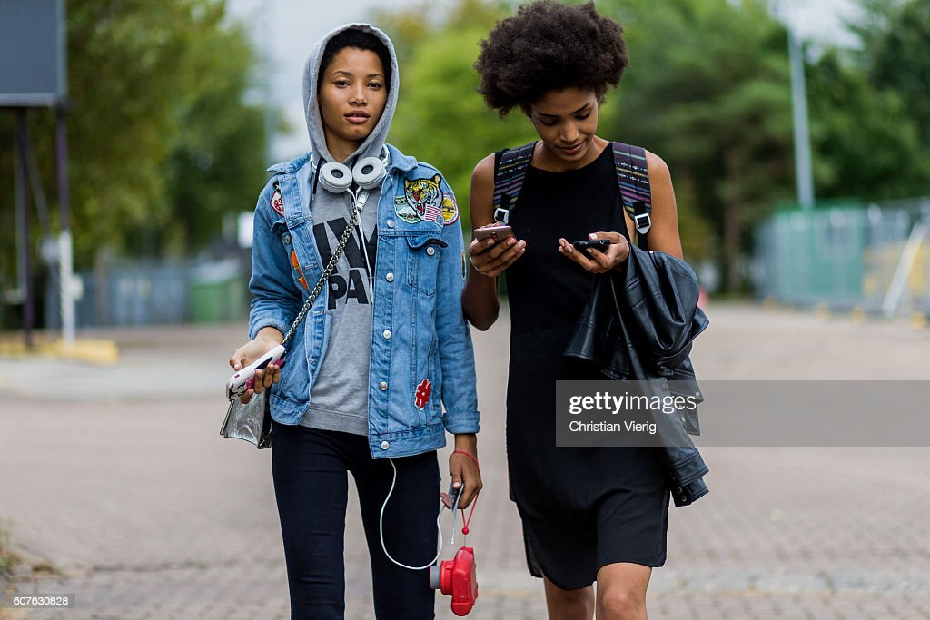 Model Lineisy Montero wearing a hoody and denim jacket outside Mulberry during London Fashion Week Spring/Summer collections 2017 on September 18, 2016 in London, United Kingdom.