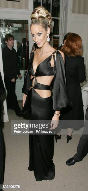 Model Lisa Butcher arrives for the House Of Hardy Amies cocktail evening of fashion and burlesque in aid of LEPRA on Savile Row in central London