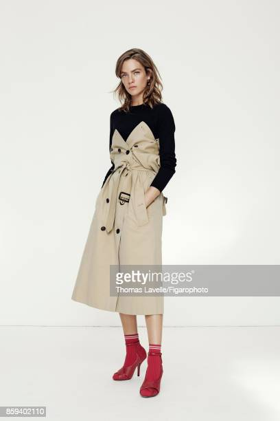 Model Lisa Louis poses at a fashion shoot for Madame Figaro on July 21 2017 in Paris France Trench shirt earrings socks and shoes PUBLISHED IMAGE...