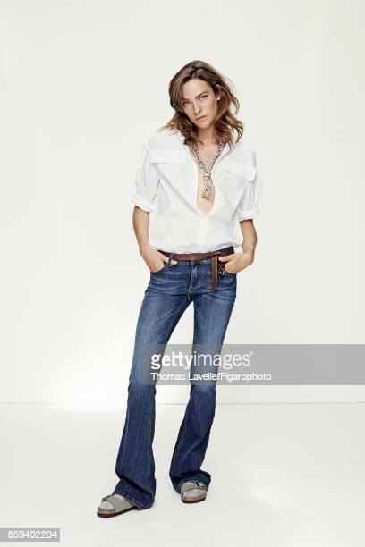 Model Lisa Louis poses at a fashion shoot for Madame Figaro on July 21 2017 in Paris France Shirt jeans necklace belt socks sandals PUBLISHED IMAGE...