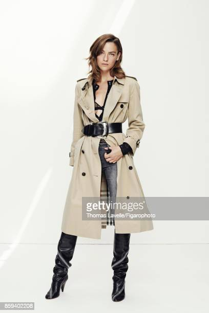 Model Lisa Louis poses at a fashion shoot for Madame Figaro on July 21 2017 in Paris France Trench body bra and belt jeans boots PUBLISHED IMAGE...